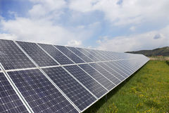 Detail of the Solar Power Station on the spring flowering Meadow in the sunny Day Royalty Free Stock Photo