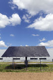 Detail of the Solar Power Station on the spring flowering Meadow in the sunny Day Stock Photos