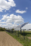 Detail of the Solar Power Station on the spring flowering Meadow in the sunny Day Royalty Free Stock Photos