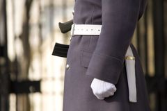 Detail of soldier carrying rifle. A detail of a soldier wearing white gloves carrying a rifle Stock Photography