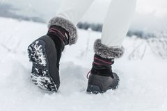 Detail on sole of black winter shoes with purple details royalty free stock photography