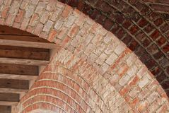 Detail of some arches in an arcade structure. stock photos