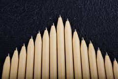 Shallow focus view of a close-up image of new pen pencils seen on dark black background. mock up. Detail of some of the beige pen pencil tips is evident, seen on royalty free stock photo