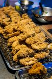 Fried chicken at a street food stall at the weekend market, Phuket, Thailand. Detail of some fried chicken at a street food stall at the weekend market, Phuket royalty free stock photos