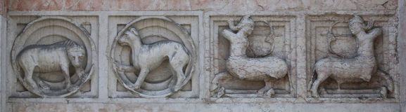 Detail of some marble medieval bas relief outside the Baptistery in Parma Royalty Free Stock Image