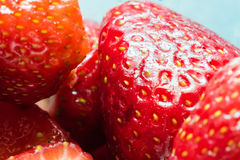 Detail of some sliced strawberries. Close-up shot, vibrant colors royalty free stock photos