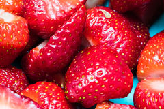 Detail of some sliced strawberries. Close-up shot, vibrant colors Stock Images