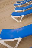 Sunbeds in the beach Royalty Free Stock Photo