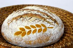 Detail of sourdough bread decorated with wheat spice in a basket Stock Photos