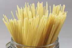 Detail of Spaghetti in a glass jar on gray background Stock Photography