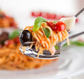 Detail of spaghetti with tomato sauce. Royalty Free Stock Image