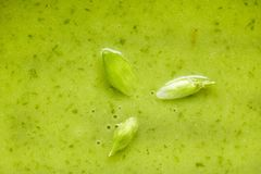 Detail of spinach soup with wild garlic flowers Royalty Free Stock Images