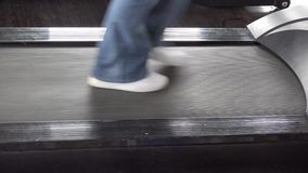 Detail of sportswear feet walking  and running on treadmill at gym. First slow and after faster, increase speed, passing throw life, UHD 4K stock video