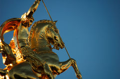 Detail of St George. Detail of a golden statue dedicated to Saint George in Tbilisi, Georgia Royalty Free Stock Photography