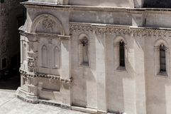 Detail of St James Cathedral in Åibenik, Croatia. Small Renaissance portraits and other ornate sculptural decorations on northern side of St James Cathedral stock photos