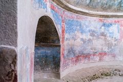 Detail of the Stabian baths in Pompeii, Italy. Detail of the Stabian baths in the excavated town of Pompeii, Italy showing a recess and remains of the wall Royalty Free Stock Images