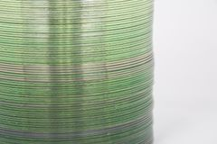 Detail of stack of cds. A stack of cds creating an abstract with light making the stack glow with A greenish cast royalty free stock images