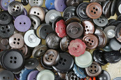 Detail of the stack of various buttons Stock Photo