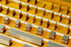 Detail of stainless steel rectangular gauge block metric etalons placed in wooden case. Detail of vintage stainless steel rectangular gauge block metric etalons Royalty Free Stock Photo