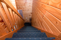 Detail of staircase in wooden lodge apartment Royalty Free Stock Photo
