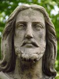 Detail of statue - Christus face on grave in old abadoned cemetary. Nice sculpture close-up royalty free stock photography