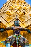 Statue of demon holding up the Golden chedi at the Wat Phra Kaew Palace, also known as the Emerald Buddha Temple. Bangkok, Thailan Stock Photo