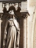 Detail of a Statue of a Saint at Notre Dame Cathedral Royalty Free Stock Photos