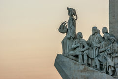 Detail of the statues of the Padrao dos Descobrimentos Monument of the Discoveries in Lisbon, Portugal. Detail at sunset of the statues of the Padrao dos Stock Photography