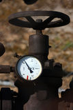 Detail of steel old valve with manometer Stock Photography