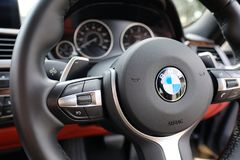 Detailed view of a luxury, german-made sports car showing detail from the drivers point of view. Detail of the steering wheel controls, horn and dials can be Stock Photography