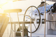 Detail of steering wheel and navigation instruments of a sailboat. blur depth of field royalty free stock photos