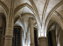 Detail, stone arches in Conciergerie, Paris, France. Paris, France, August 29, 2015: Stone arches in Conciergerie are lit by spotlights royalty free stock photography