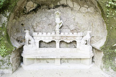 Detail of a stone bench with statues Stock Photography