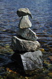 Detail of stone cairn on water background Royalty Free Stock Photos