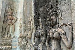 Detail of a Stone Carved Relief in the famous Angkor Wat in Camb Stock Photos