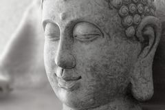 Detail of stone figure of Buddha gray stock photos