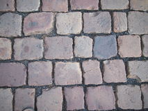 Detail of stone square pavement. On the ground Royalty Free Stock Photo