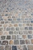 Street with texture of cobblestone stock photography