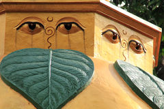 Detail of Stupa with eyes at Buddhist Temple in Bali, Indonesia. Stone carved stupa detail with eyes and leaves in garden at Buddhist Temple in Bali, Indonesia royalty free stock photography
