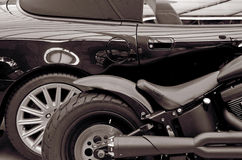 Detail stylish black car and motorcycle. Lifestyle. (Opposites,. Contrast, power - concept stock photo