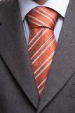 Detail of a suit and a tie. In double windsor knot - isolated royalty free stock photos