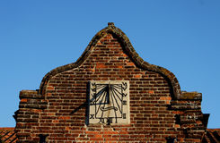 Detail of Sundial in an old building Facade Stock Photography