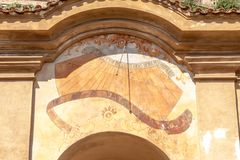 The detail of sundial painted on the portal in Small Palffy Garden. Stock Photos