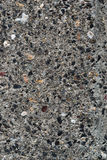 Detail of surface texture with small pebble rock on dirty ground Royalty Free Stock Images