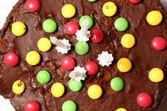 Detail of Sweet birthday tart with colorful candies Royalty Free Stock Images
