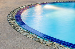 Detail of Swimming Pool - Clear Blue Water. Side of a swimming pool with clear blue water Royalty Free Stock Images
