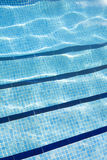 Detail of Swimming pool with sunlight reflecting on the water Stock Images