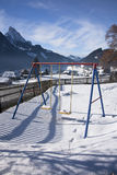 Detail of swing in Gstaad, Switzerland, in winter with snow Royalty Free Stock Image