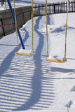 Detail of swing in Gstaad, Switzerland, in winter with snow Royalty Free Stock Photos