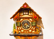 The detail of swiss wooden clock Stock Image